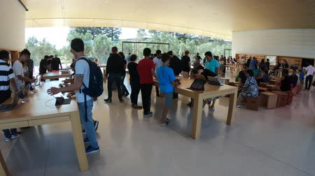 apple headquarter : Cupertino, CA, United States - August 12, 2018: interior with many customers in the new Apple store and Headquarters of Apple Park Visitor Center, Tantau Avenue, Cupertino, Silicon Valley, California