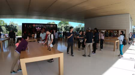 apple headquarter : Cupertino, CA, United States - August 12, 2018: interior with customers in the new Apple store and HQ of Apple Park Visitor Center, Tantau Avenue, Cupertino, Silicon Valley, California