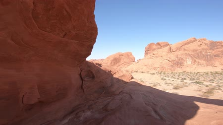 valley of fire : POV inside the Arch Rock, a natural arch along Valley of Fire scenic loop. Nevadas oldest state park famous for red sandstone formations. Sunset red color. Stock Footage