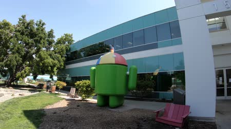 silicon : Mountain View, California, United States - August 13, 2018: Android Noogler statue dedicated to new employees who in the first week have to wear a rainbow hat with a propeller and the word Noogler.