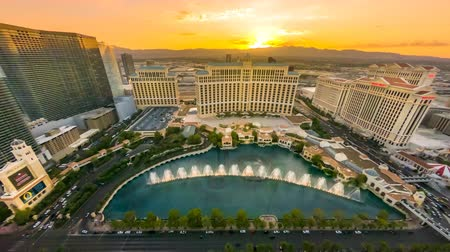bellagio : Las Vegas, Nevada, United States - August 18, 2018: TIME-LAPSE of Bellagio Casino dancing fountains at sunset show from Eiffel Tower of Parisian luxury Resort Hotel Casino in Las Vegas Strip.