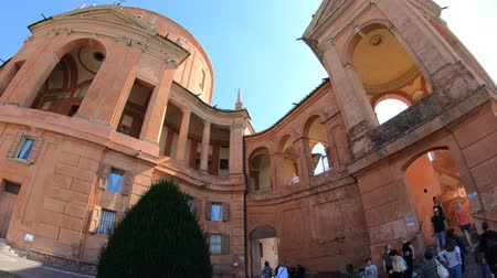 madona : Bologna, Italy - September 29, 2018: courtyard of Madonna of San Luca Sanctuary on Bologna hills with international tourists resting at the end of a relaxing Italian summer. Dostupné videozáznamy