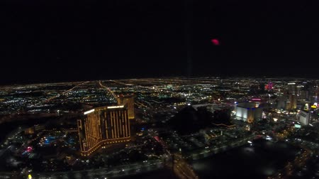 pyramida : Las Vegas, Nevada, United States - August 18, 2018: aerial view of Las Vegas Skyline by night. Scenic flight above Luxor pyramid Hotel Casino with light show and Mandalay Bay Resort Casino.