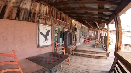 sundurma : Calico, CA, USA - August 15, 2018: Fossils and Minerals and wooden porch in Cowboy Theme Park.Calico was designated Silver State Rush Ghost Town of California, San Bernardino County.