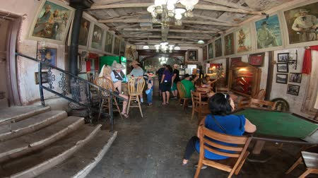 kísértet : Calico, CA, USA - August 15, 2018: POV entering inside Saloon of cowboys in Calico, the silver mine Ghost Town of California near Barstow, San Bernardino.