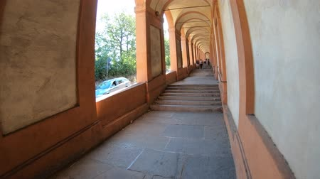 madona : A sporty woman running under San Lucas portico: the longest porch in the world leading to the San Luca Sanctuary on Colle della Guardia. Bologna city of Italy.