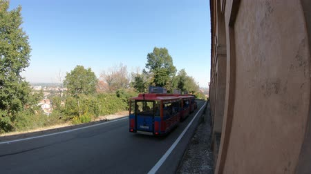 madona : Bologna, Italy - September 29, 2018: train to San Luca sanctuary beside the porch stairway from Bologna city downtown.