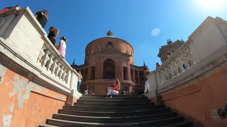 madona : Bologna, Italy - September 29, 2018: tourists taking pictures on the stairway of Holy Mary of San Luca church in Bologna on holiday.
