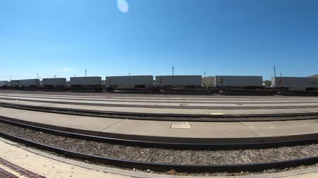 ave : Barstow, California, USA - August 15, 2018: panorama of Barstow train station tracks on blue sky. Train Station Platform with Shelter in North First Avenue.
