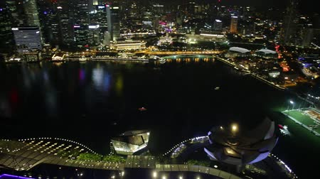 night singapore : Wide panorama at night of Singapore Marina Bay with illuminated skyscrapers of the financial district in the downtown of the city. Singapore cityscape aerial view.
