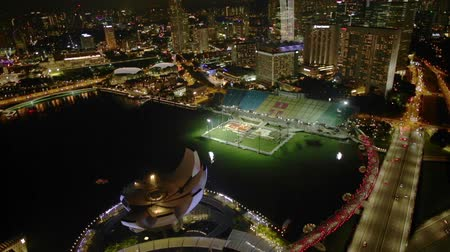 skypark : Singapore Marina Bay Aerial view of highway illuminated at night on the harbor. Singapore skyline and night urban scene. Stock Footage