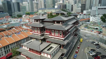 relics : Singapore - April 28, 2018: tilt shift top view of Buddha Tooth Relic Temple of Singapore from aerial, Southeast Asia. Spectacular buddhist temple in Chinatown district with business district skyline.