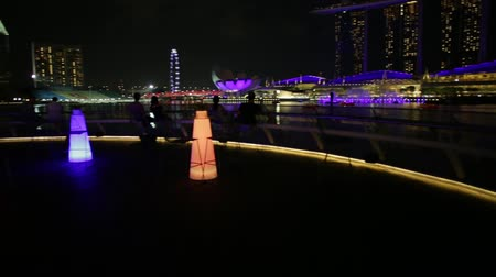 skypark : Singapore - April 28, 2018: Marina Bay Sands with colored lights during laser show seen from roof of The Fullerton Pavilion, Italian restaurant Monti At 1-Pavilion in Singapore harbor by night.