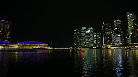 skypark : Singapore - April 27, 2018: great laser show at night time at Marina Bay Sands Hotel and Casino and ArtScience Museum. Laser lights on the waters of Marina Bay Waterfront promenade in Singapore.
