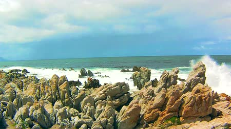 pinguim : Ocean waves on the rocks in Penguin Nature Reserve, Bettys Bay, South Africa.