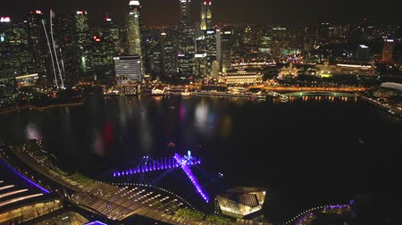 skypark : Singapore - May 3, 2018: Night laser show. skyline of Singapore marina with financial district skyscrapers at night in the harbor. Rooftop above Singapore skyline. Night urban scene.