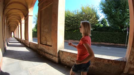 madona : sporty running woman under the archway San Lucas portico. San Luca Sanctuary on Bologna city hills, Italy.