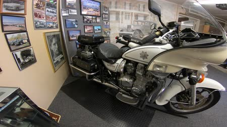 sheriff : San Diego, California, USA - August 2, 2018: Classic Highway Patrol Police motorcycle of 1980s at historic police museum. Sheriffs Museum of Old Town of San Diego. Stock Footage
