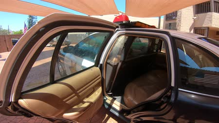 sheriff : San Diego, California, USA - August 2, 2018: back seats of police car Ford Crown Victoria Police Interceptor at Sheriffs Museum of Old Town of San Diego. Stock Footage