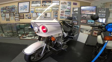 sheriff : San Diego, California, USA - August 2, 2018: 1980s Highway Patrol Police motorcycles with lights and sirens on at historic police museum. Sheriffs Museum of Old Town of San Diego.