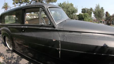 hearse : Los Angeles, California, United States of America - August 6, 2018: vintage Rolls Royce Silver Cloud hearse of 1950s in Hollywood Forever Cemetery. Stock Footage