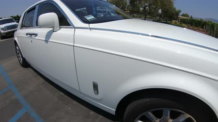 california rolls : Santa Ynez, California, USA - August 2018: white Rolls Royce car at Vincent Vineyards Winery, a fine wine producer of California.