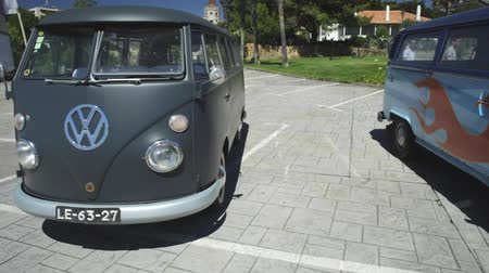 minibus : Cascais, Portugal - August 6, 2017: historic Volkswagen hippie vans minibus in the vintage cars show in historic Cascais town center. Stock Footage