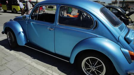 volkswagen : Cascais, Portugal - August 6, 2017: round view of an historic Volkswagen Beetle car of blue color during the vintage cars show in historic Cascais town center.