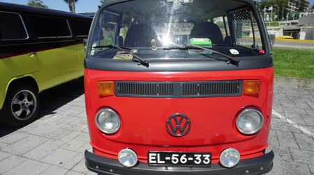 minibus : Cascais, Portugal - August 6, 2017: round view of an red Volkswagen hippie Van in the vintage cars show in historic Cascais town center.