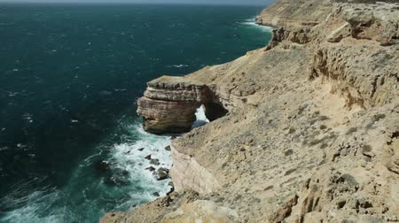 np : Aerial view of Natural Bridge lookout in Kalbarri National Park, WA, Australian Outback and Indian Ocean cliffs.