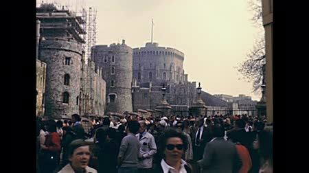 windsor : LONDON, UNITED KINGDOM - CIRCA 1979: king Henry VIII gate of Windsor Castle. Royal residence at Windsor in the English county of Berkshire. Historic restored footage in 1970s.