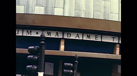 70年代 : LONDON, UNITED KINGDOM - CIRCA 1979: signboards of London planetarium and Madame Tussauds wax museum. Historic restored footage in 1970s with people in vintage dress.