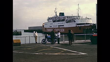 Нормандия : DOVER, UNITED KINGDOM - CIRCA 1979: People in vintage dress at Dover port with Townsend Thoresen Ferries. Historic restored footage in 1970s.