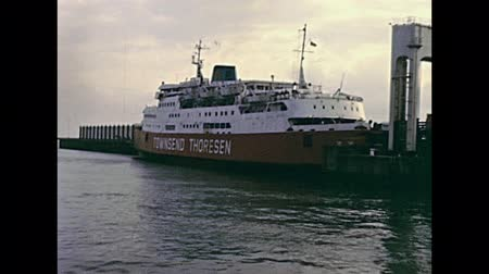 70年代 : DOVER, UNITED KINGDOM - CIRCA 1979: Townsend Thoresen Ferries and Normandy Ferries in Dover port. Historic restored footage in 1970s.
