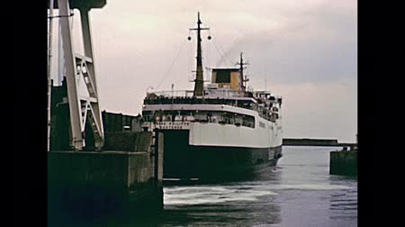 Нормандия : DOVER, UNITED KINGDOM - CIRCA 1979: on board of ferry departing from Dover port with people in vintage dress. Historic restored footage in 1970s.