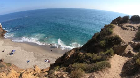 promontory : Aerial view of Pirates Cove, a hidden sandy beach in a small cove on west side of Point Dume, Malibu coast in CA, United States. California West Coast. Blue sky, summer season, sunny day. Copy space. Stock Footage