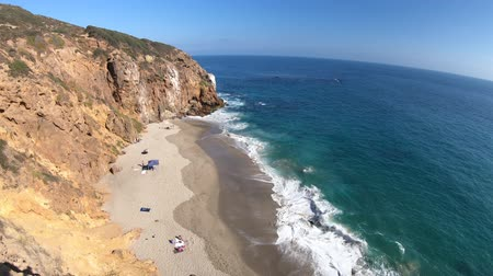 promontory : Californian aerial view of Pirates Cove beach, a small cove on west side of Point Dume, Malibu coast, United States. Blue sky, summer season, sunny day. Pacific coast in CA. Copy space. Stock Footage