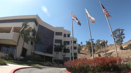 intézmény : Malibu, California, United States - August 7, 2018: Direction and Executive Center of Pepperdine University with American, Californian and Malibu flag waving.The main campus is on Malibu hills.