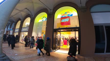 lego : BOLOGNA, ITALY- DECEMBER 6, 2018: the famous constructions toy bricks, Lego shop of Bologna. Storefront full of people for the recent inauguration.