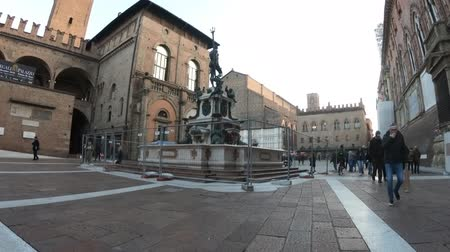 palazzo : Bologna, Italy - December 7, 2018: Neptune 1567 bronze statue and fountain in front of Accursio palace. Perspective view from the shame-stone, where a penis silhouette can be seen on the statue.