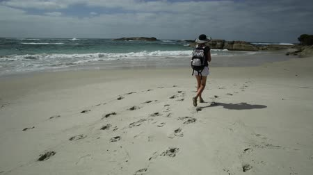 william : photographer Woman in hat, holding a camera at Waterfall Beach in Denmark, Western Australia. Backpacker at William Bay national park, a popular Australian travel destination. Stock Footage