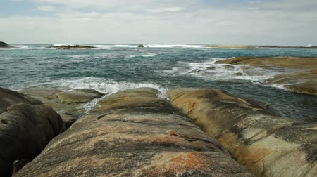 np : POV to the sea on the rocks of waterfall Beach in Denmark, Western Australia. Great Southern Ocean coastline in William Bay National Park. Sunny day, blue sky. Australian travel summer destination. Stock Footage