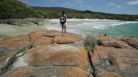 william : Backpacker travel photographer walking to the sea at Waterfall Beach in Denmark, Western Australia. William Bay national park, popular Australian travel destination.