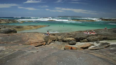 np : Calm and sheltered waters of Greens Pool in William Bay National Park, Denmark, Western Australia. Tourists swimming and sunbathing in summer holidays. Popular travel destination in Australia. Stock Footage