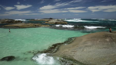 np : Sheltered Greens Pool from the waves of the Great Southern Ocean. Rounded rock boulders typical to this area, paradise for swimming and sunbathing. William Bay NP, Denmark, Western Australia.