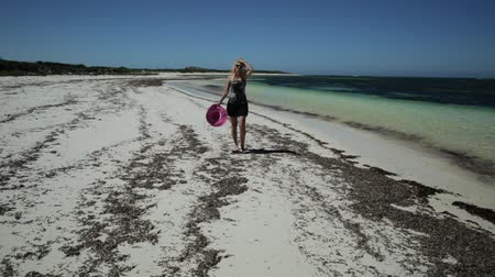yalınayak : Joyful happy woman walking on seashore of white sand in popolar Hangover Bay, Cervantes, Nambung National Park, Western Australia. Blonde girl happiness walk. Copy Space Stok Video