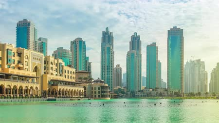 birleşik arap emirlikleri : Scenic panorama view of skyscrapers at sunset of Old Town Island and Dubai Mall, around the Burj Khalifa Lake, Dubai Downtown.