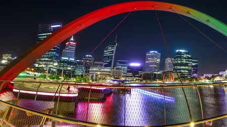 grãos : Panorama of coloful arcade and illuminated walkway of Elizabeth Quay Bridge by night at Elizabeth Quay Marina in Perth, Western Australia. Central business district reflecting on Swan River.