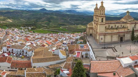 malaga : Panorama of Olvera and Cathedral seen from the Castle of the famous village de la Ruta de los Pueblos Blancos, white villages, between Cadiz and Malaga, Andalusia, Spain. Stock Footage