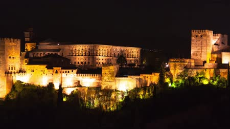 grãos : Panoramic view of the famous Alhambra Royal Palace by night from the best viewpoint. This site is known as one of the most beautiful in the world and is a Unesco heritage. Granada, Andalucia, Spain.